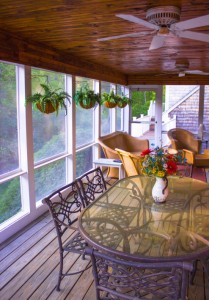 Photo: Outdoor dining room on a screened porch